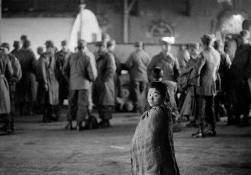 "Werner Bischof ""At the train station, South Korea, Pusan, 1952""Town of Pusan, which became the capital of Republic  of Korea during the Korean War."
