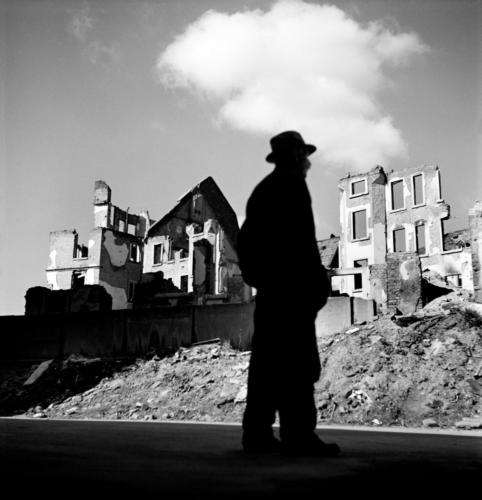 "Werner Bischof ""Germany,  Frankfurt, 1946""A man looking at the ruined city."