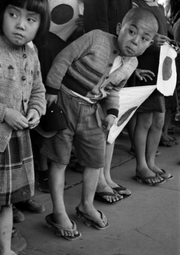 "Werner Bischof ""Japan, Hiroshima, 1951""Children waiting for the arrival of Emperor Hirohito."