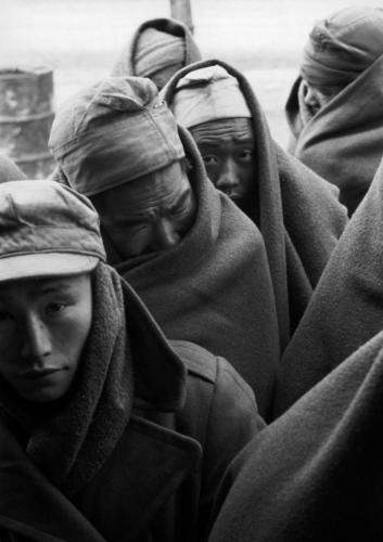 "Werner Bischof ""South Korea, Koje Do Island, 1952""Re-education camp for Chinese and North Korean prisoners. North Korean prisoners waiting for medical treatment."